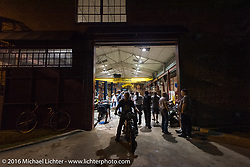 Busy with repairs in the Coker Tires shop during the hosted stop at their headquarters in Chattanooga, Tennessee after the finish of stage 3 of the Motorcycle Cannonball Cross-Country Endurance Run, which on this day ran from Columbus, GA to Chatanooga, TN., USA. Sunday, September 7, 2014.  Photography ©2014 Michael Lichter.