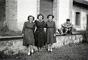three girls posing outside the train station at Daumazan-sur-Arize France