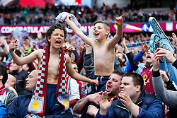 Young suporters celebrate in the stands after Aston Villa win the match 2-1 to reach the 2015 FA Cup Final - Photo mandatory by-line: Rogan Thomson/JMP - 07966 386802 - 19/04/2015 - SPORT - FOOTBALL - London, England - Wembley Stadium - Aston Villa v Liverpool - FA Cup Semi Final.