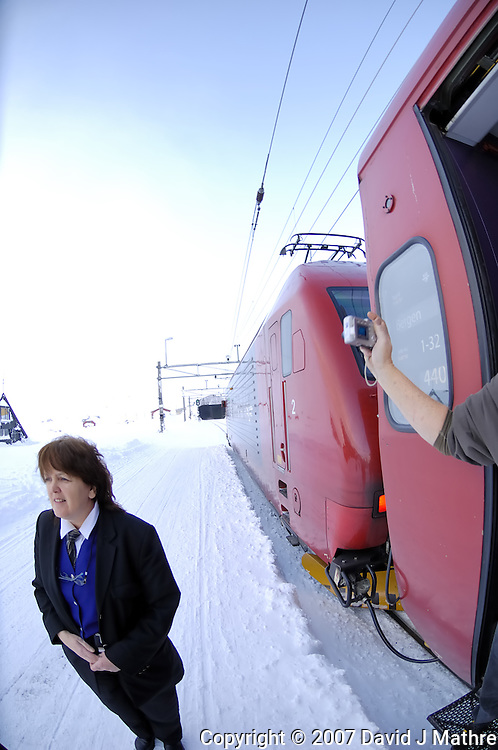 Conductor on the Bergen Railroad at Finse, Norway. Image taken with a Nikon D2xs and 10.5 mm f/2.8 Fisheye lens (ISO 100, 10.5 mm, f/4, 1/60 sec)