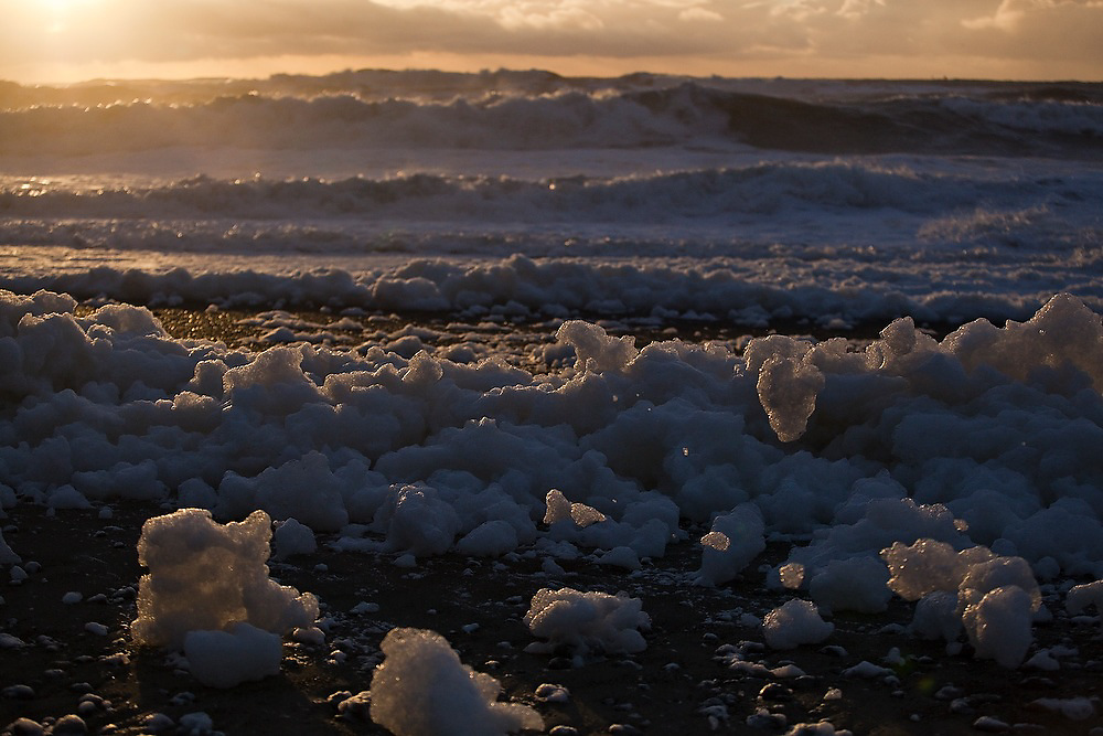 Piles of sea foam on First Beach near La Push, Olympic Peninsula, Washington.
