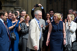 © London News Pictures. 09/05/2016. London, UK. Leader of the Labour Party, JEREMY CORBYN, greets new Labour MPs Chris Elmore (left) and Gill Furniss (right) outside the Houses of Parliament in London following elections last week. Photo credit: Ben Cawthra/LNP