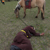 A rural herder lies passed out after drinking too much fermented mare's milk at a naadam festival on a remote pass near Muren, Mongolia. Sadly, alcoholism is a serious national problem.