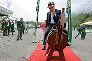 Moscow, Russia, 20/09/2003..The opening day of the Moscow Polo Club, featuring the Russian Polo Cup 2003, the first event of its kind in Russia since the 1917 Bolshevik revolution. Russians try out their polo skills on a wooden horse..