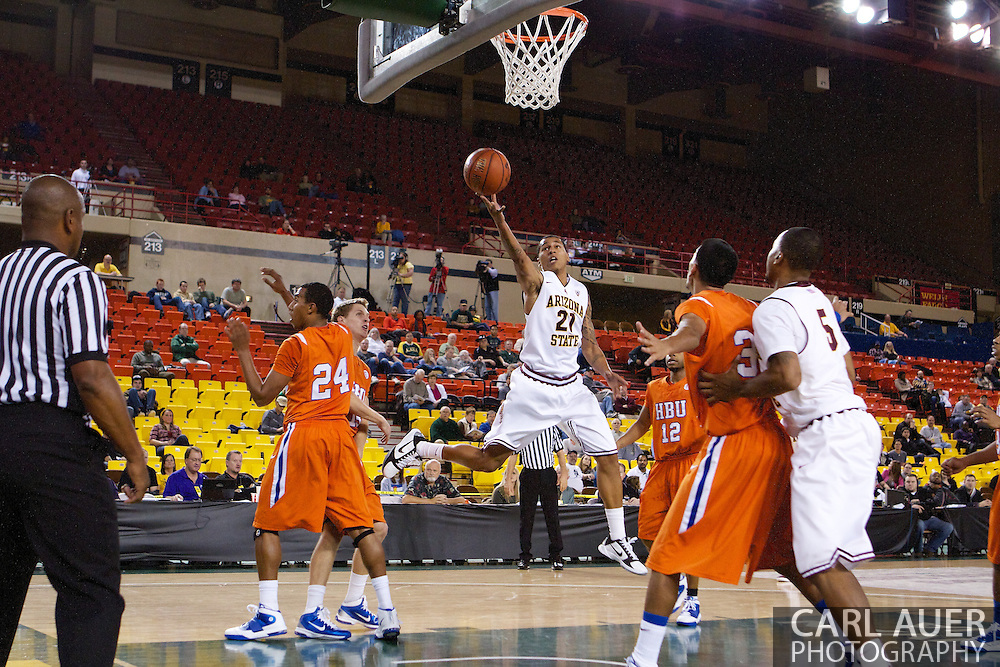 November 25th, 2010:  Anchorage, Alaska - Arizona State guard Keala King (21), splits the Houston Baptist defense for a lay up in the Sun Devils 73-55 win over Houston Baptist at the Great Alaska Shootout.