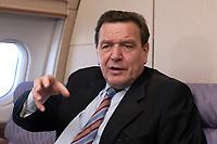 20 NOV 2003, LUFTRAUM:<br /> Gerhard Schroeder, SPD, Bundeskanzler, waehrend einem Interview in einem Airbus 310 der Flugbereitschaft der Bundesluftwaffe, im Luftraum zwischen Deutschland und den USA<br /> IMAGE: 20031120-01-025<br /> KEYWORDS: Gerhard Schröder