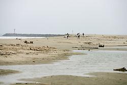 Surfers On Orond Beach