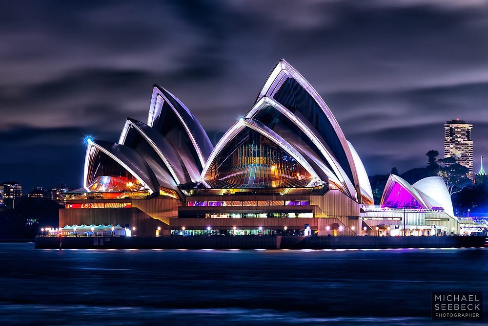 The Sydney Opera House at night, captured from across Sydney Harbour.<br /> <br /> Code: LANM0015<br /> <br /> Limited Edition Print