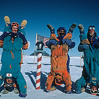 Members of the 1989-1990 Trans-Antarctica Expedition clown for a picture at the ceremonial South Pole.