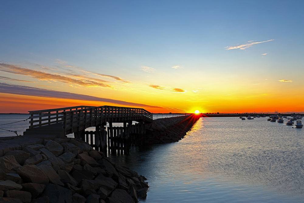 Sunrise Seaview photography of the harbor jetty with its wooden bridge at dawn in Plymouth, MA. The town of Plymouth is most famous for its historic landmarks and sites such as Plymouth Rock, the Mayflower and Plimoth Plantation. <br /> <br /> Plymouth Massachusetts seascape fine art photography prints are available as museum quality photo prints, canvas prints, acrylic prints or metal prints. Prints may be framed and matted to the individual liking and interior design decorating ideas:<br /> <br /> https://juergen-roth.pixels.com/featured/plymouth-harbor-jetty-juergen-roth.html<br /> <br /> Good light and happy photo making!<br /> <br /> My best,<br /> <br /> Juergen<br /> Prints: http://www.rothgalleries.com<br /> Photo Blog: http://whereintheworldisjuergen.blogspot.com<br /> Instagram: https://www.instagram.com/rothgalleries<br /> Twitter: https://twitter.com/naturefineart<br /> Facebook: https://www.facebook.com/naturefineart