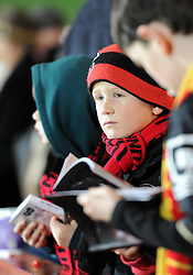 A young Bournemouth supporter watch his team warm-up - Photo mandatory by-line: Paul Knight/JMP - Mobile: 07966 386802 - 17/12/2014 - SPORT - Football - Bournemouth - Goldsands Stadium - AFC Bournemouth v Liverpool - Capital One Cup