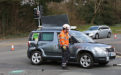 A CAR overturned on a busy junction in Southampton after a crash involving an ambulance this morning.The grey Skoda was lying on its side at the crossroads of Tebourba Way and Oakley Road.A second, red Skoda was also involved in the collision and was parked up nearby. The driver, a woman in her 40s, was shocked but unharmed.<br /> <br /> Traffic on Tebourba Way was being diverted while Oakley Road was closed following the collision, which happened shortly before 9.20am this morning.<br /> <br /> It finally reopened just after 11am.