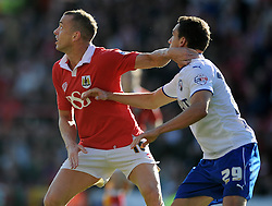 Bristol City's Aaron Wilbraham and Chesterfield's Georg Margreitter jostle for the ball - Photo mandatory by-line: Dougie Allward/JMP - Mobile: 07966 386802 - 11/10/2014 - SPORT - Football - Bristol - Ashton Gate - Bristol City v Chesterfield - Sky Bet League One