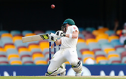 Australia's Steve Smith ducks a bouncer from Chris Woakes during day three of the Ashes Test match at The Gabba, Brisbane.