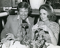 1978 Radio commentator/interviewer, Gregg Hunter is seen interviewing Millicent Martin, during his KIEV radio show at the Hollywood Brown Derby Restaurant, on Vine St.