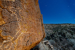 Mountain lion pictograph and night sky, Ladder Ranch, west of Truth or Consequences, New Mexico, USA.