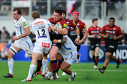 Saracens Hooker (#2) John Smit is tackled by Exeter Chiefs Inside Centre (#12) Jason Shoemark and Prop (#3) Hoani Tui during the first half of the match - Photo mandatory by-line: Rogan Thomson/JMP - Tel: Mobile: 07966 386802 16/02/2013 - SPORT - RUGBY - Allianz Park - Barnet. Saracens v Exeter Chiefs - Aviva Premiership. This is the first Premiership match at Saracens new home ground, Allianz Park, and the first time Premiership Rugby has been played on an artificial turf pitch.