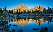 Peaks lit by sunrise reflect in pond at East Lake, in Hoover Wilderness of Humboldt-Toiyabe National Forest, Mono County, Eastern Sierra Nevada, California, USA. Our backpack from Green Creek Trailhead to Summit Lake was 7.6 mi with 2360 ft gain, 310 ft descent, over a leisurely 3 days, then out on the fourth day. A day hike from our Green Lake campsite to West Lake was 3.9 mi with 1830 ft gain to 8896 ft elev. From Summit Lake, we day hiked east to Burro Pass with a view to Virginia Lakes (2180 ft gain over 4 miles round trip). Multiple overlapping photos were stitched to make this panorama.
