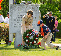 Jonathan Nelson and Patrick Gandini of Scout troup 243 have the honor of placing the wreath at the Armed Forces Memorial in Pine Grove Cemetery during the Memorial Day parade and ceremonies Monday morning.  (Karen Bobotas/for the Laconia Daily Sun)