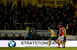 Burton Albion's Scott Fraser celebrates his side's first goal of the game during the Carabao Cup, Fourth Round match at the Pirelli Stadium, Burton.