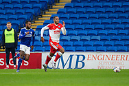 Millwall's Kenneth Zohore (13) breaks away from Cardiff City's Leandro Bacuna (7) during the EFL Sky Bet Championship match between Cardiff City and Millwall at the Cardiff City Stadium, Cardiff, Wales on 30 January 2021.