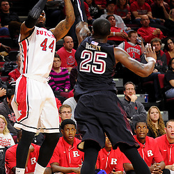 J.J. Moore #44 of the Rutgers Scarlet Knights takes a shot over Quenton DeCosey #25 of the Temple Owls during the second half of Rutgers men's basketball vs Temple Owls in American Athletic Conference play on Jan. 1, 2014 at Rutgers Louis Brown Athletic Center in Piscataway, New Jersey.