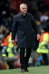 Manchester United manager Jose Mourinho after throwing a rack of water bottles while celebrating after Marouane Fellaini scores his side's first goal of the game