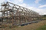 Wooden oak frame of house under construction