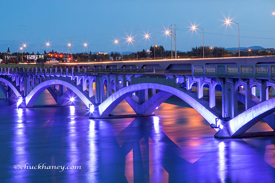 Historic Ninth Street Bridge glows at dusk on the Missouri River in Great Falls, Montana, USA