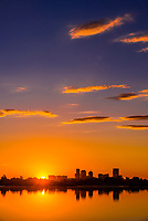 Sunrise at Sloans Lake with Downtown Denver in background, Colorado USA. Sloan's Lake is the biggest lake in Denver, and at 177 acres, it's the city's second largest park.