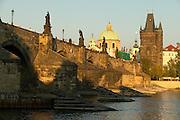 Czeck Republic - Prague, Statues above the  Charles bridge with the dome of K?ízovnické nám?stí behind.