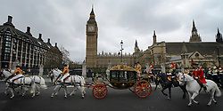 © Licensed to London News Pictures. 09/05/2012. Westminster, UK The procession carrying Queen Elizabeth II on its way back from the Palace of Westminster today 9th May 2012. It is the first Queen's Speech, the grandest event on the parliamentary calendar, since shortly after the coalition Government was formed. The statement usually takes place each autumn. Photo credit : Stephen Simpson/LNP