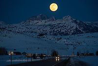 """The full moon rises over Mt. Moran on March 20 in this view from just north of Tetonia, Idaho. It was the first time in 19 years a full moon has landed on the spring equinox. It is also a """"super moon,"""" when the moon is closer to the Earth and appears 14 percent larger and 12 percent brighter than usual. Finally, in the north the March full moon is also known as the worm moon, because it coincides with the time of year when earthworms begin to emerge from the thawing soils."""
