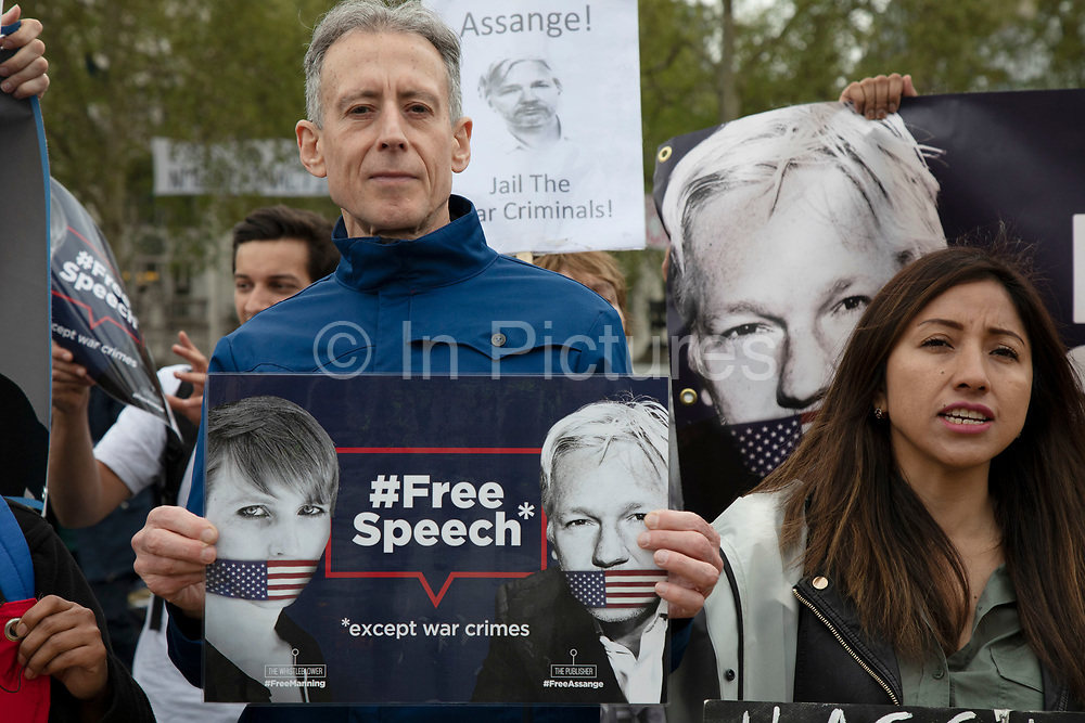 Protesters including rights campaigner Peter Tatchell calling to free Julian Assange outside Parliament on 24th April 2019 in London, England, United Kingdom. The Wikileaks founder Julian Assange was arrested and is currently serving a prison sentence after he was found guilty of breaching the Bail Act and on 1 May 2019 was sentenced to 50 weeks in prison in the United Kingdom. Peter Tatchell is a British human rights campaigner, originally from Australia, best known for his work with LGBT social movements.