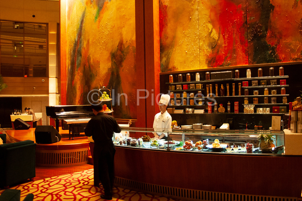 Chef in the bar area on the 55th floor of the Jin Mao Building. The top section of this amazing tower is owned by the Grand Hyatt hotel up the 85th floor. This is one of Shanghai's premier hotels, and the bar area here is the base of the Hyatt's amazing atrium space.