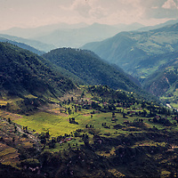 Terraced hillsides of the Himalaya stretch south from the Annapurna Massif, Nepal.
