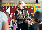 PRICE CHAMBERS / NEWS&GUIDE<br /> Davey Jackson Elementary second grade teacher Patty Berlin reacts to a student's question about the Thanksgiving crafts they work on with a class of kindergarteners Tuesday morning.