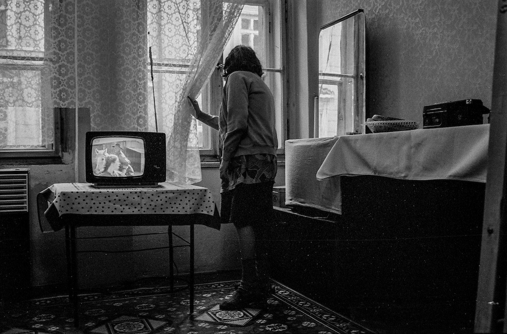 A woman in her flat in Prague Zizkov.