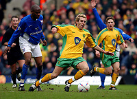 PICTURE BY DANIEL HAMBURY/SPORTSBEAT IMAGES<br />Nationwide Football League Division One    7/3/04<br /><br />NORWICH CITY V IPSWICH TOWN<br /><br />Ipswich Town's Drissa Diallo trips Norwich City striker Darren Huckerby on the edge of the box and is sent off for the challange