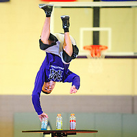 012213  Adron Gardner<br /> <br /> Narciso Baca grabs himself a sports drink while flipping over a table to entertain the crowd during a basketball half-time break at Miyamura High School in Gallup Tuesday.