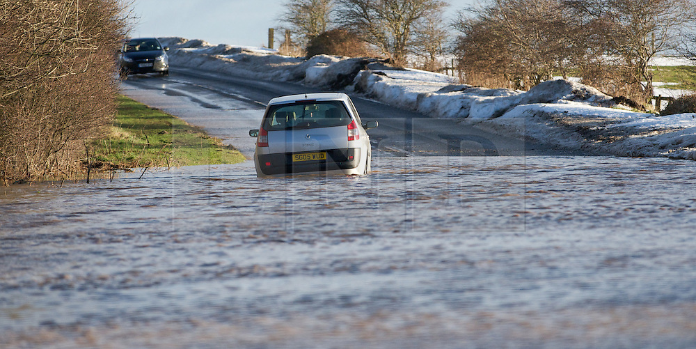 © Licensed to London News Pictures. 27/01/2013..Cleveland, England, UK..Following the recent snowfall a fast thaw through the night brought heavy flooding to some parts of Cleveland and North Yorkshire with many roads closed...An abandoned car sits in heavy flood water near to Boulby in East Cleveland...Photo credit : Ian Forsyth/LNP