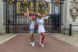 Licensed to London News Pictures. 11/07/2021. London, UK. Fans dress up in England gear next to Buckingham Palace, London ahead of England's Euro 2020 finals match. England take on Italy in the Euro 2020 final at the iconic Wembley Stadium this evening. Photo credit: Alex Lentati/LNP
