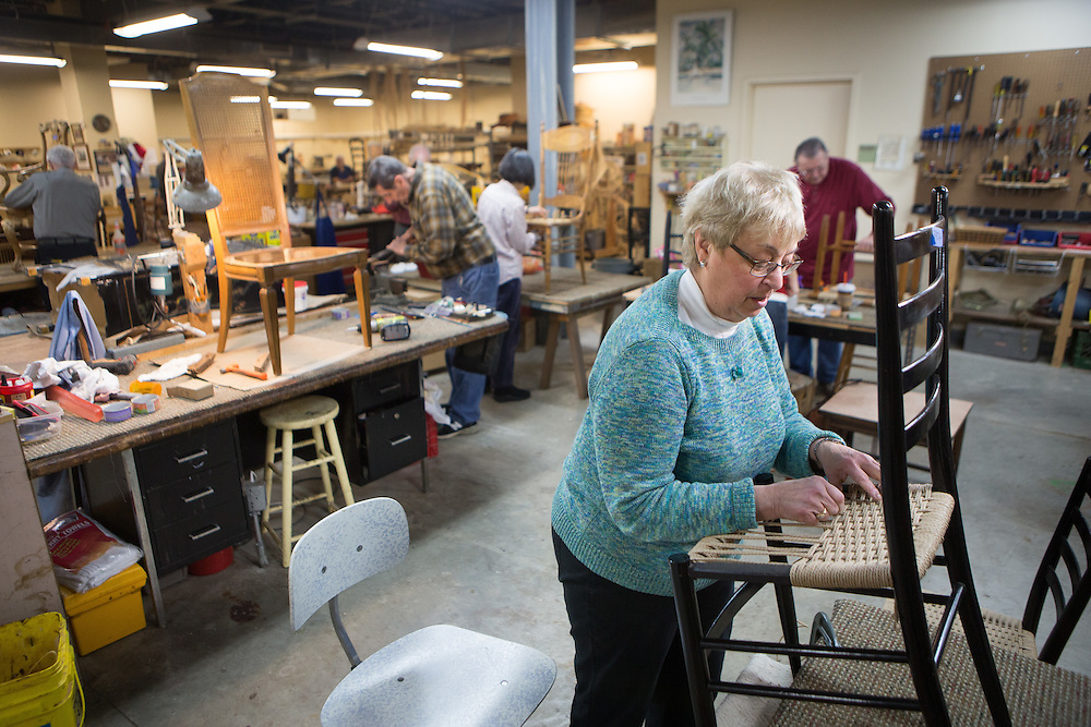 Marsha Foregger of Berkeley Heights restores the caning on a chair at the Sage Eldercare furniture restoration workshop in Summit.  1/5/14 Photo by John O'Boyle