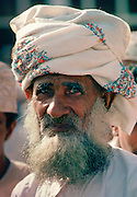 An Omani man with grey beard and moustache in Oman