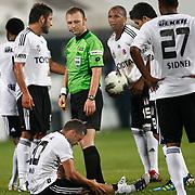 Referee's Tolga OZKALFA (C) during their Turkish superleague soccer match Besiktas between MKE Ankaragucu at BJK Inonu Stadium in Istanbul Turkey on Monday, 19 September 2011. Photo by TURKPIX