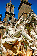ITALY, ROME Piazza Navona with Fountain of Four Rivers  by Bernini, created for Pope Innocent X with St. Agnese beyond