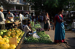 Vendors sell their produce in the vegetable market in Anand, India on April 14, 2007. Once famous as the milk capital of India, home to the country's most successful dairy farmer cooperative, the city is now known for Dr. Nayna Patel's controversial surrogacy program.