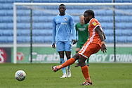 Shrewsbury Town midfielder Anthony Grant (42) looks to release the ball during the EFL Sky Bet League 1 match between Coventry City and Shrewsbury Town at the Ricoh Arena, Coventry, England on 28 April 2019.