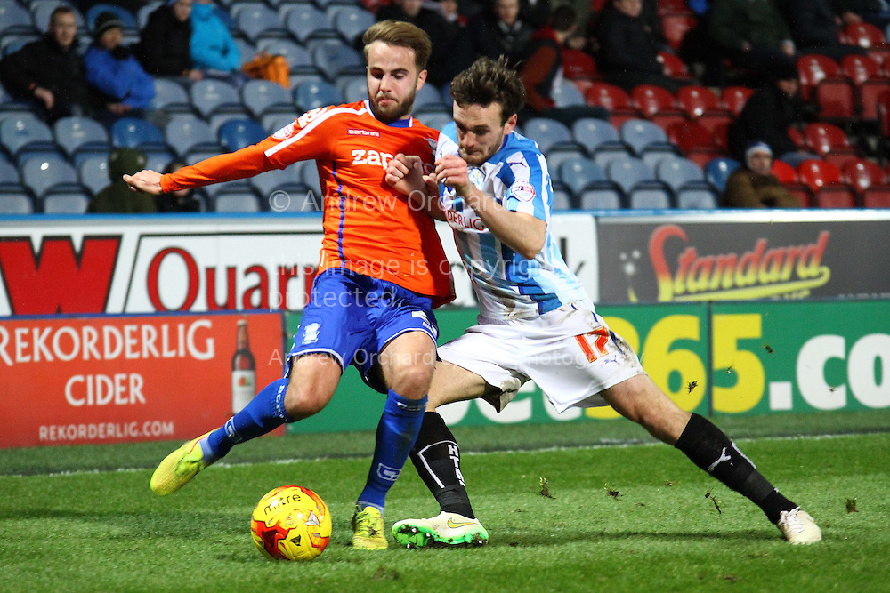 Andrew Shinnie of Birmingham City (l) and Jack Robinson of Huddersfield Town challenge for the ball. Skybet football league championship match, Huddersfield Town v Birmingham city at the John Smith's stadium in Huddersfield, Yorkshire on Saturday 20th December 2014.<br /> pic by Chris Stading, Andrew Orchard sports photography.