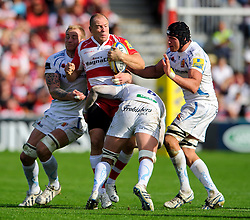Gloucester Outside Centre (#13) Mike Tindall is tackled by Exeter Flanker (#6) Tom Johnson during the second half of the match - Photo mandatory by-line: Rogan Thomson/JMP - Tel: Mobile: 07966 386802 - 03/10/2013 - SPORT - RUGBY UNION - Kingsholm Stadium, Gloucester - Gloucester Rugby v Exeter Chiefs - Aviva Premiership.